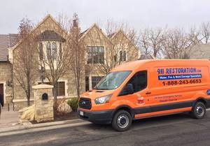 Water Damage Restoration Van At Residential Job